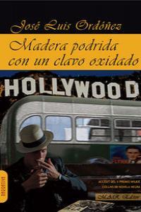MADERA PODRIDA CON UN CLAVO OXIDADO: portada